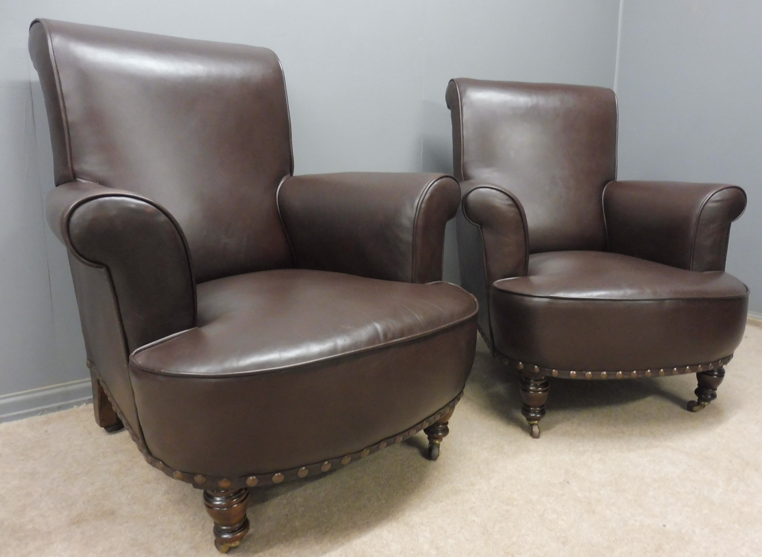 good pair of antique leather armchairs