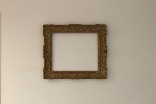an early c20th carved wood and painted frame