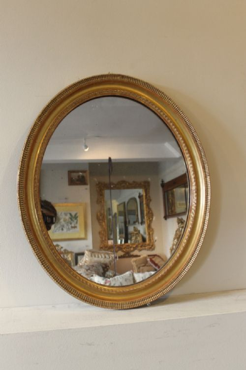 french gilded ripple style oval mirror
