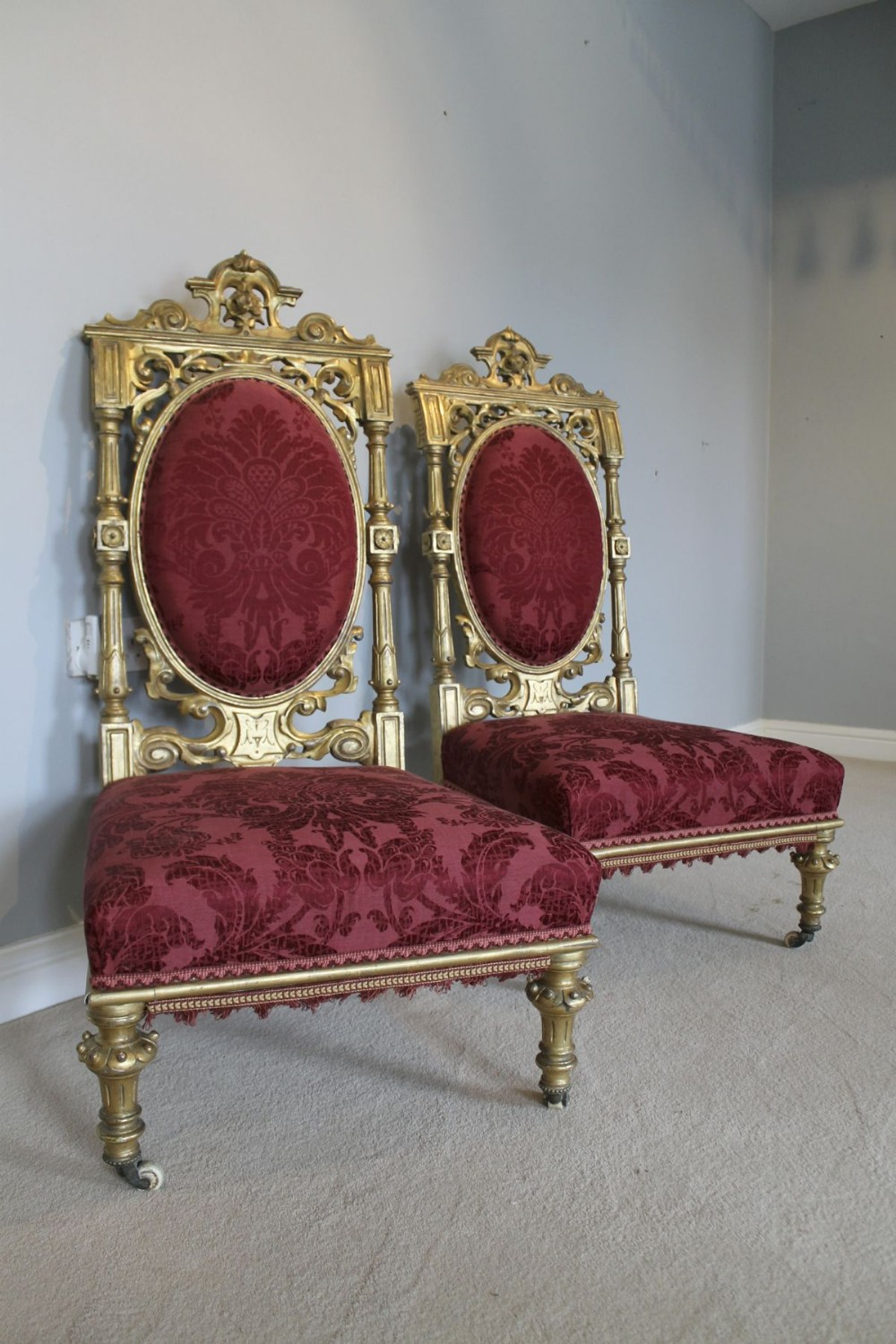 a pair of aesthetic movement carved and gilded chairs