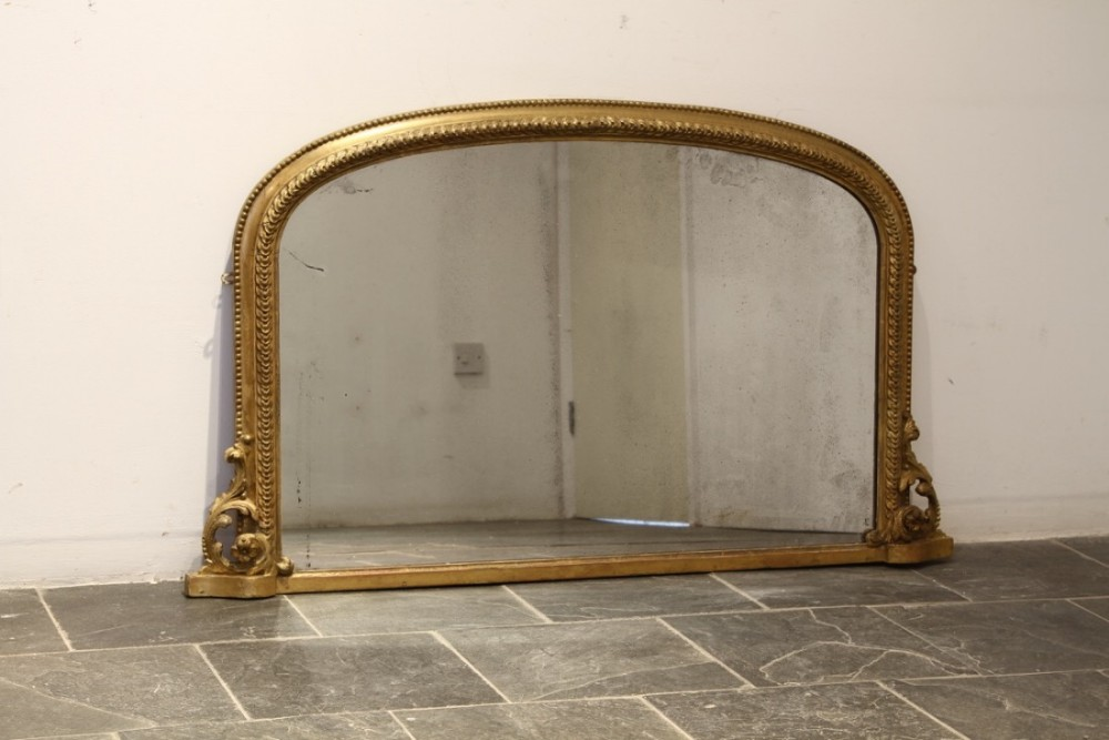 an english nineteenth century composition and gilded overmantel mirror
