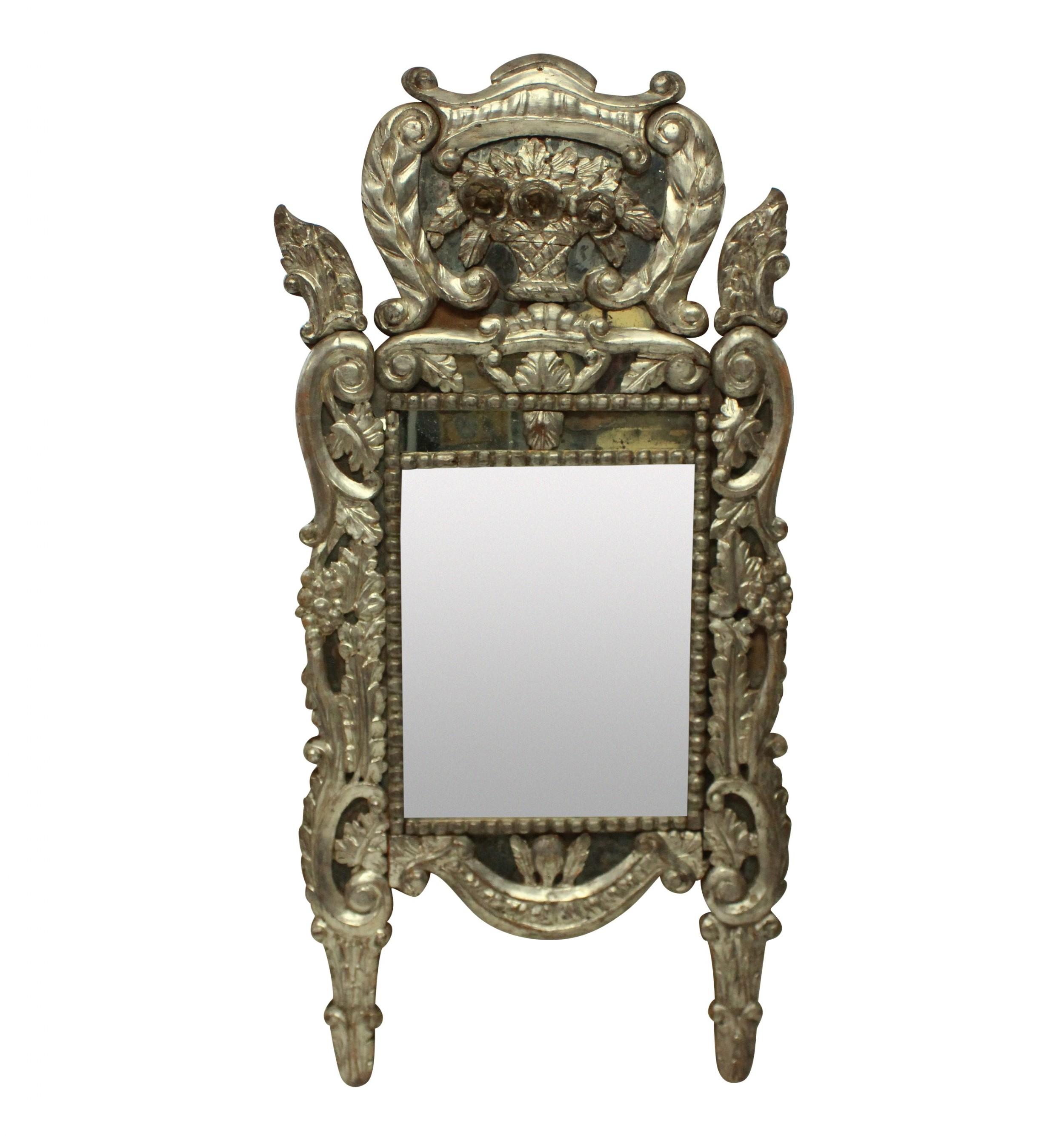 an xviii venetian mirror in silver leaf