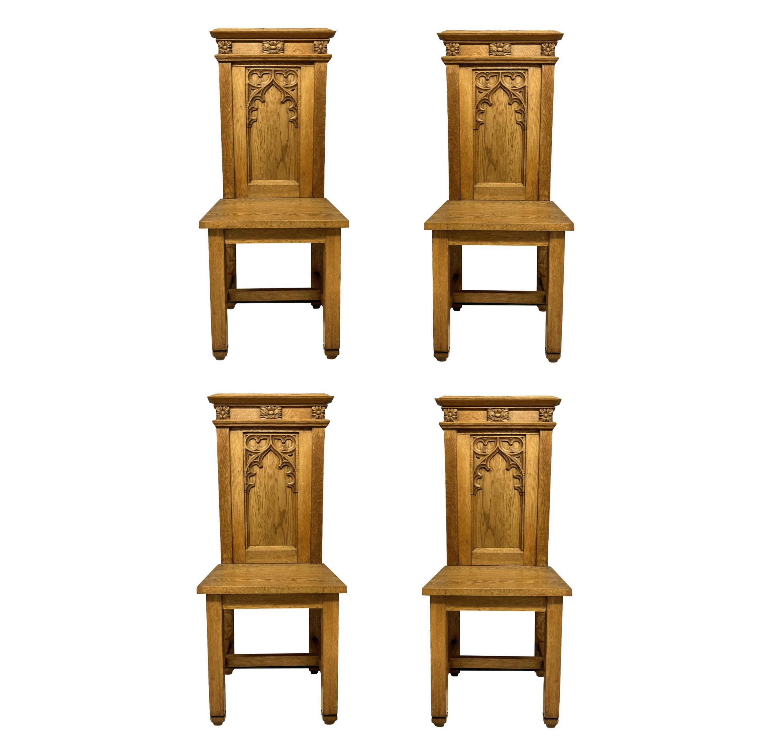a set of four english oak gothic hall chairs