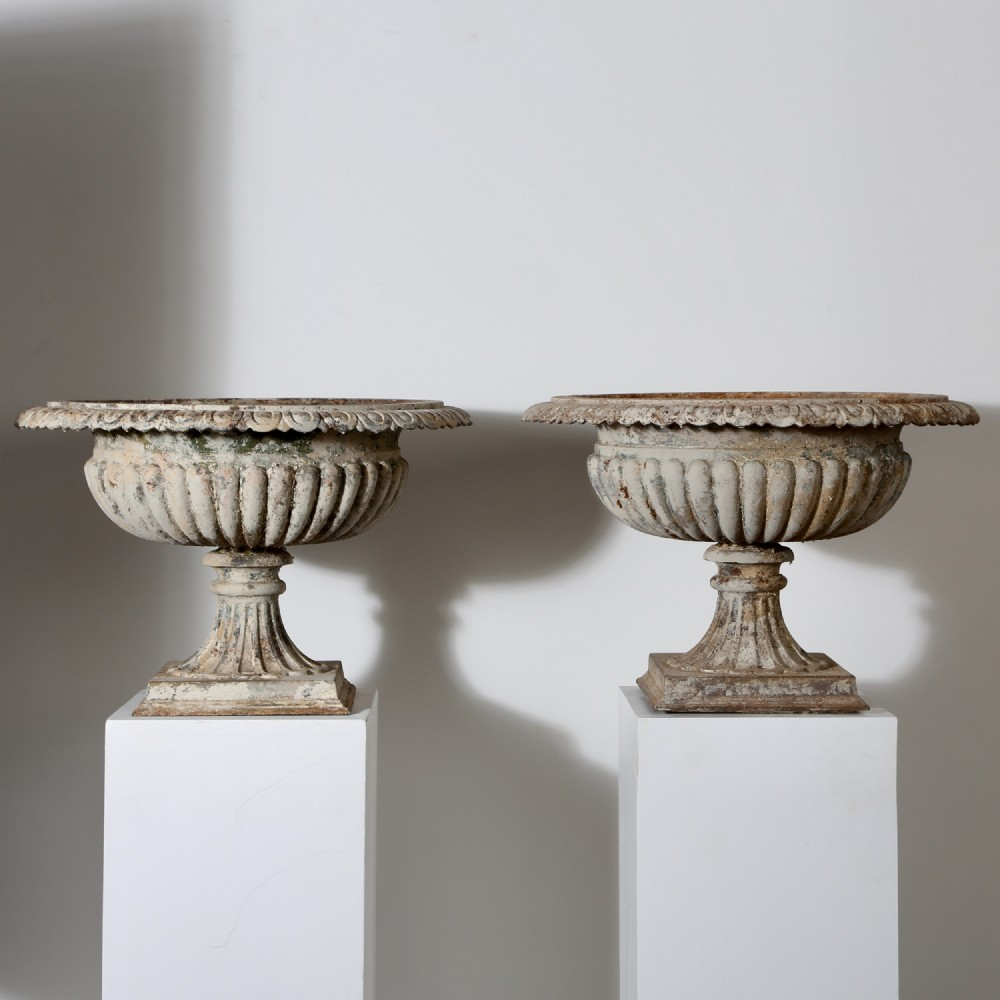 a pair of 19th century cast iron urns