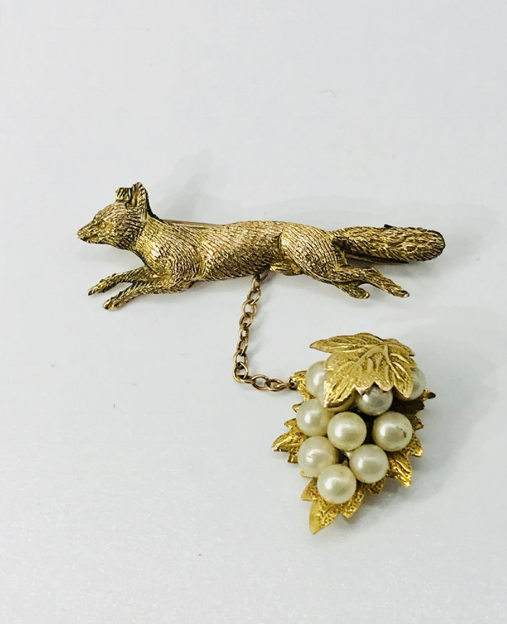 charming late victorian 9ct gold fox brooch with gold and seed pearl grapes c1880