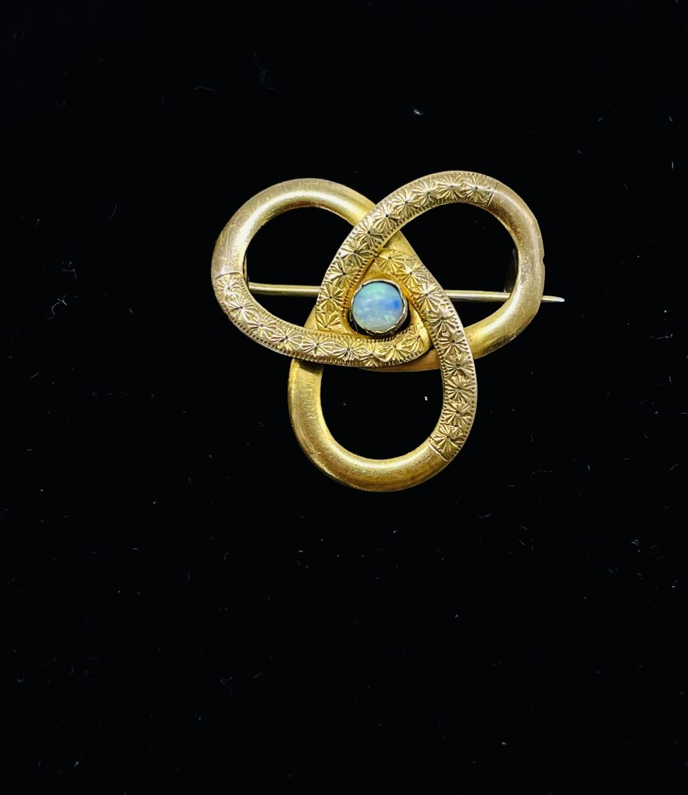 beautiful neoclassical revival period 9ct gold brooch set with a central opal c1920