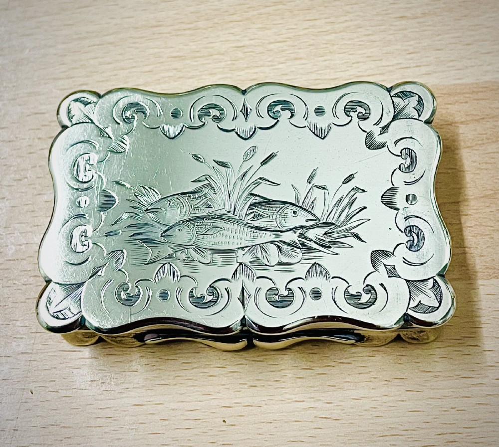 mid victorian silver snuff box with bright cut engraved fish motifs c1870