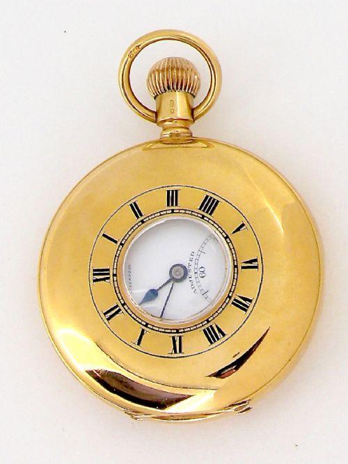 an 18 carat gold half hunter pocket watch