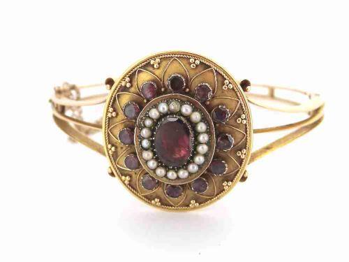 a fine victorian garnet and pearl bangle