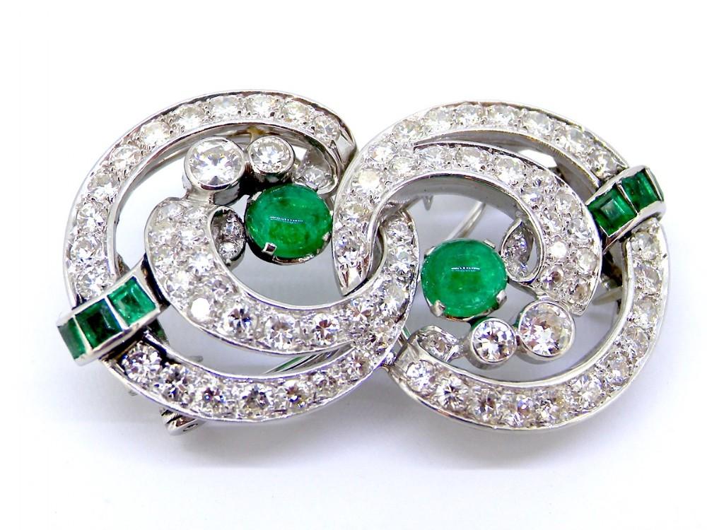 a fabulous platinum art deco emerald and diamond clip brooch