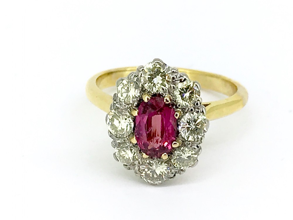 a fine antique ruby and diamond cluster ring