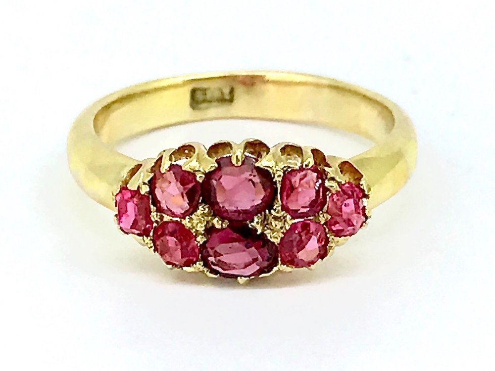 an antique ruby cluster ring