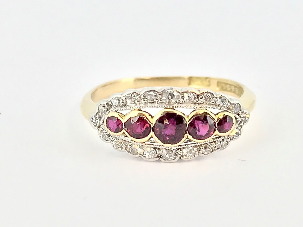 an edwardian oval ruby and diamond cluster ring