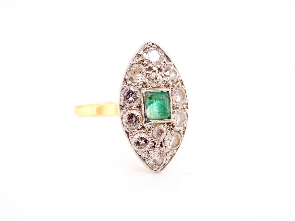 an art deco period emerald and diamond cluster ring