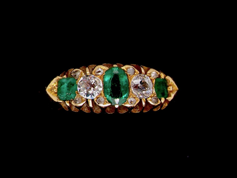 an 18 carat gold victorian emerald and diamond ring