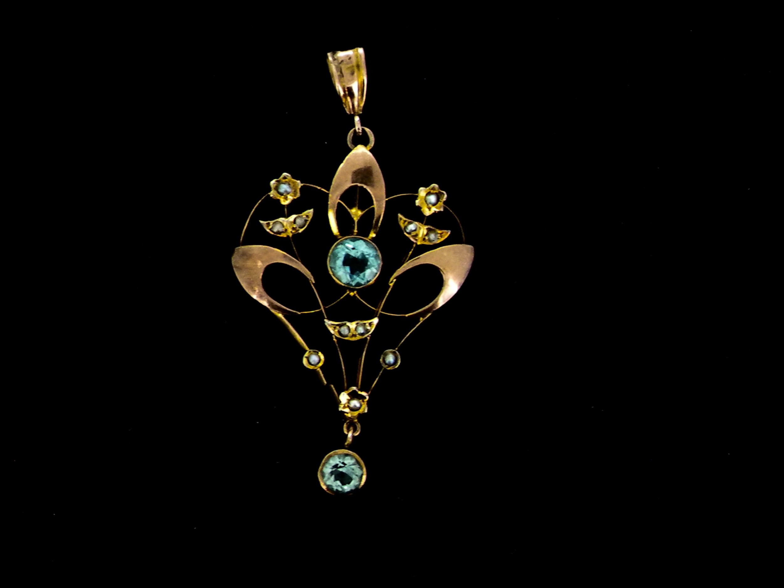 a 9 carat gold victorian blue zircon and pearl pendant