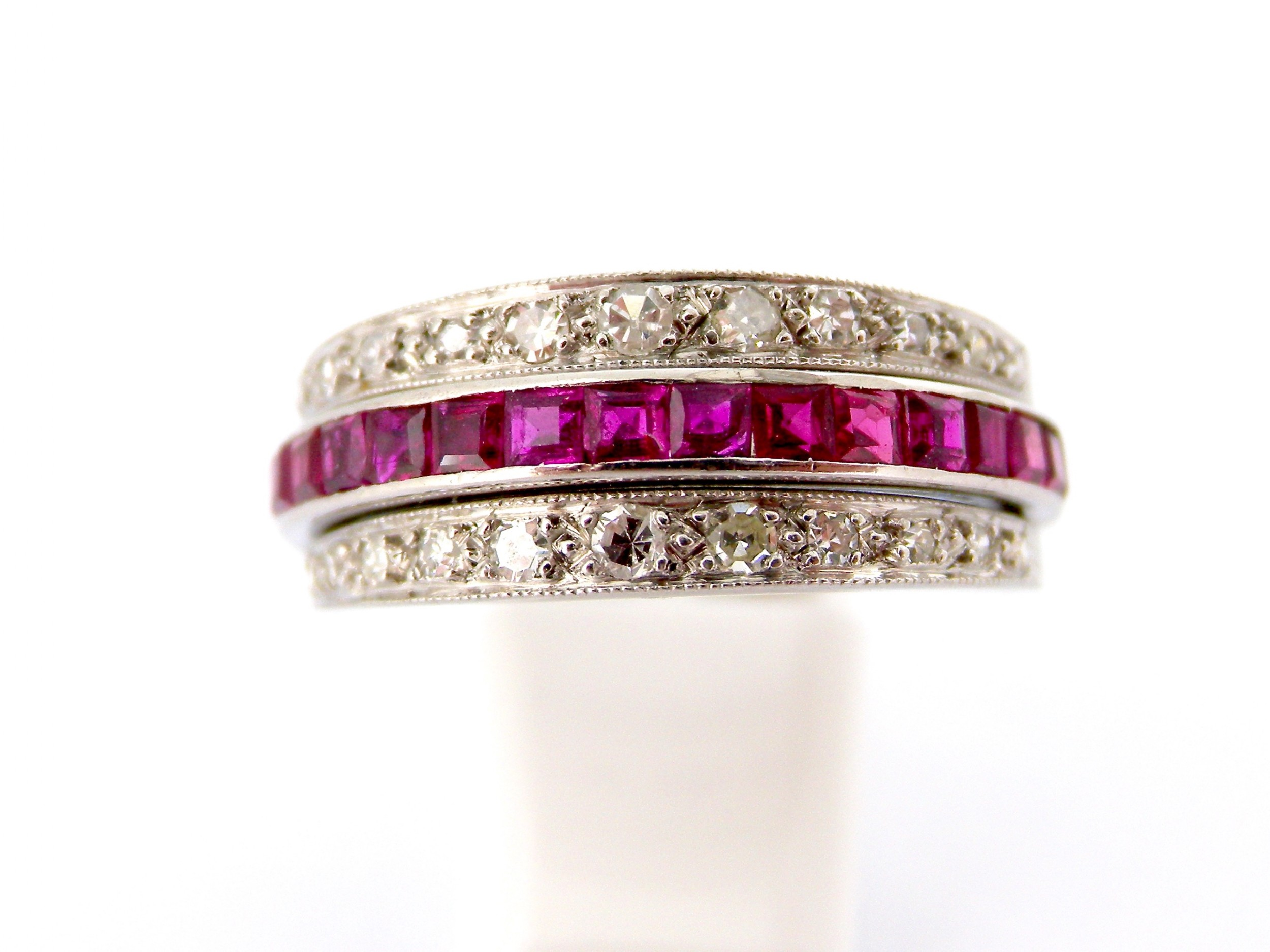 a platinum 'night and day' ruby sapphire and diamond swivelling ring