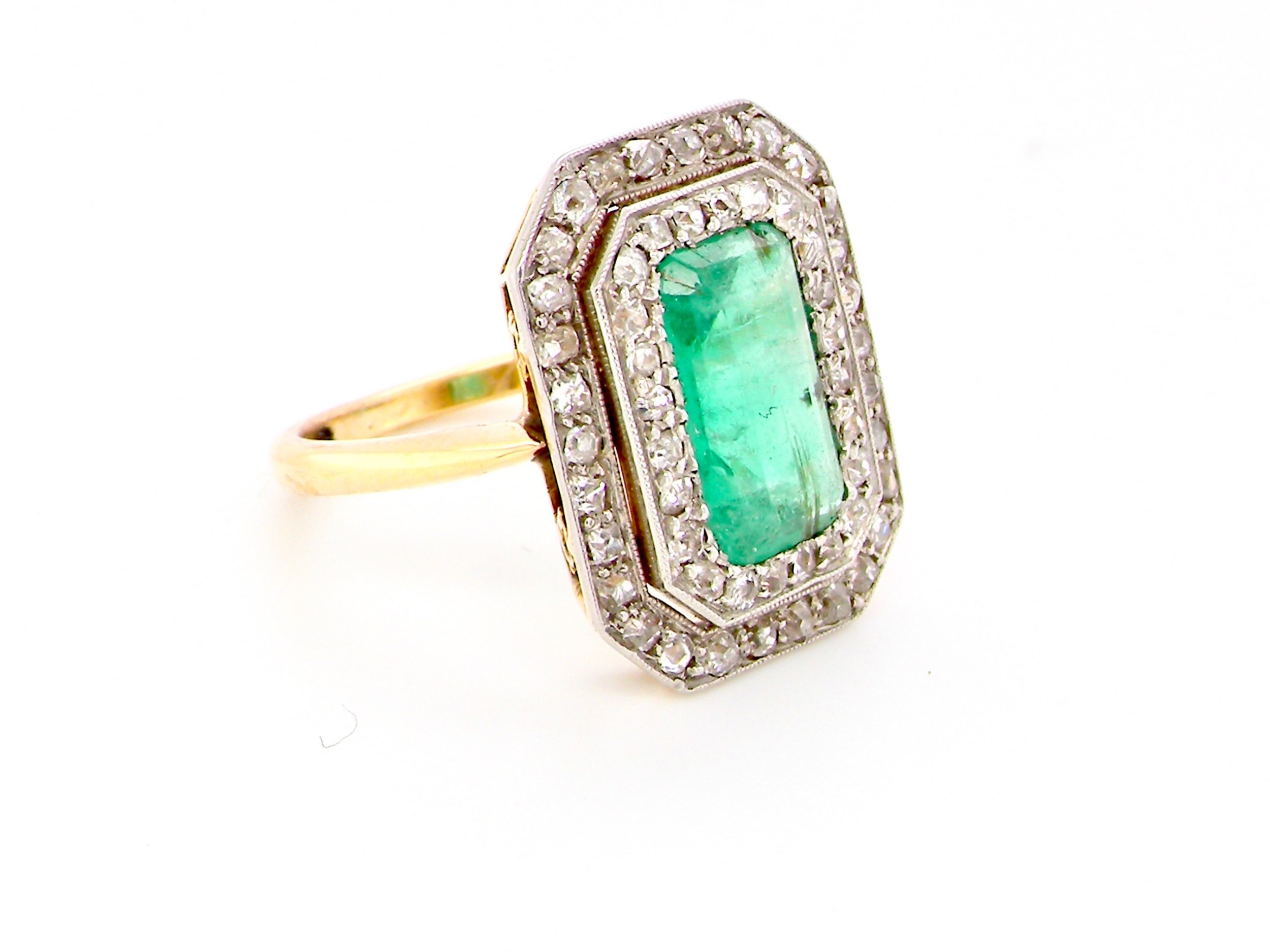 an exceptional edwardian period emerald and diamond cluster ring