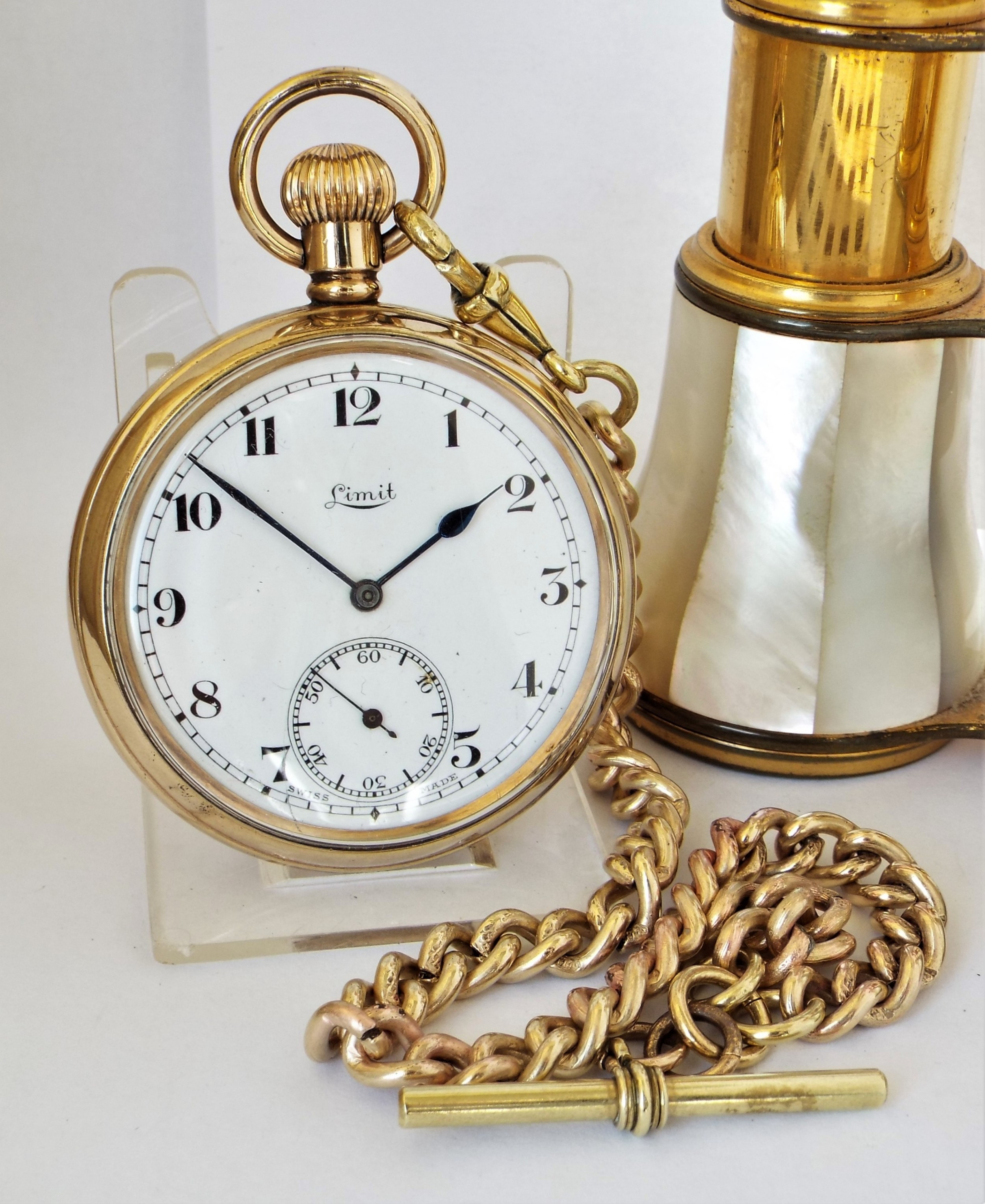 a 1920s limit pocket watch and chain