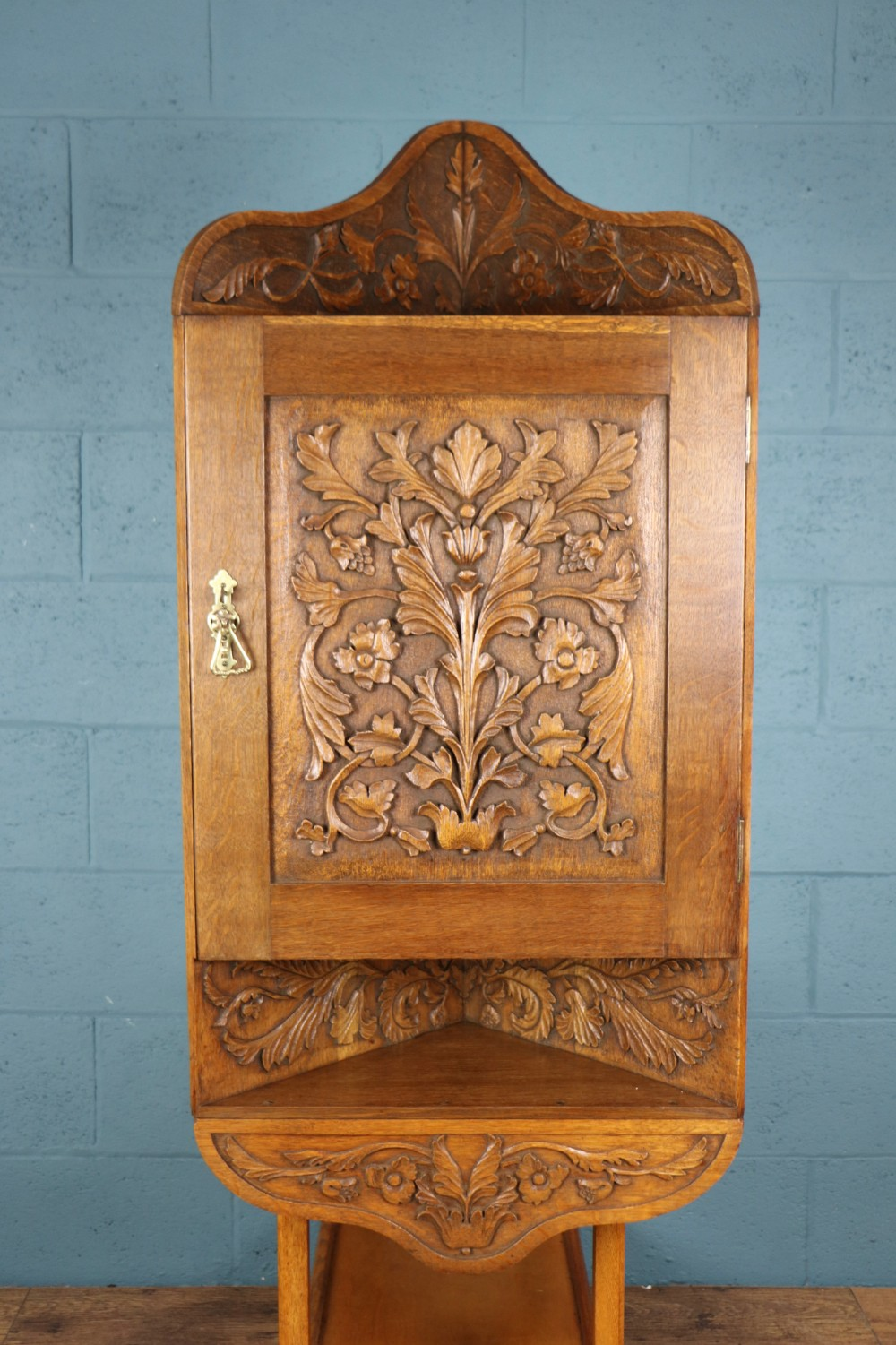 arts and crafts hand carved oak corner cupboard