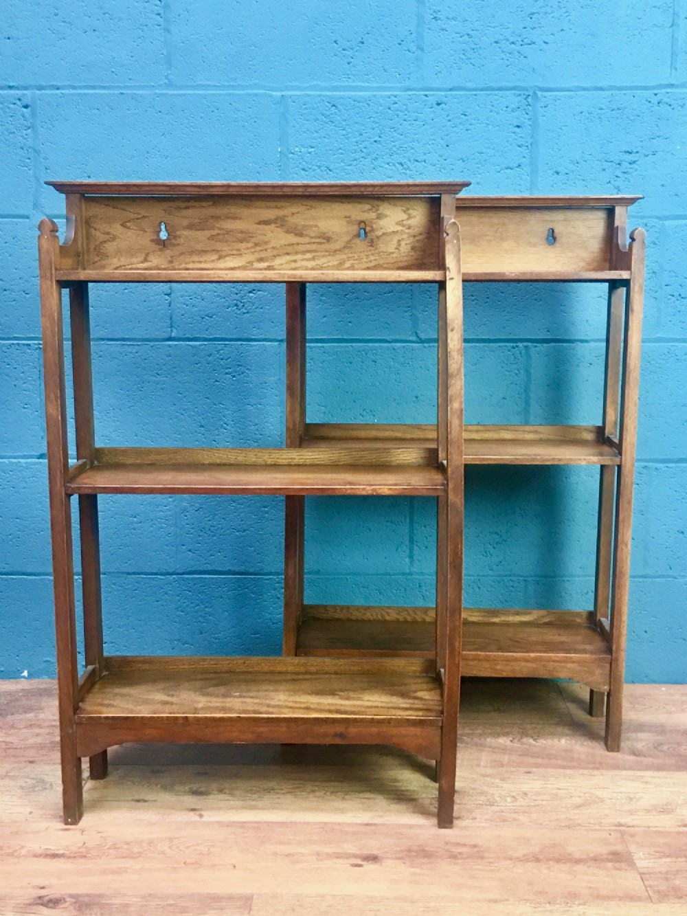 pair of matching oak bookcases in the style of heals