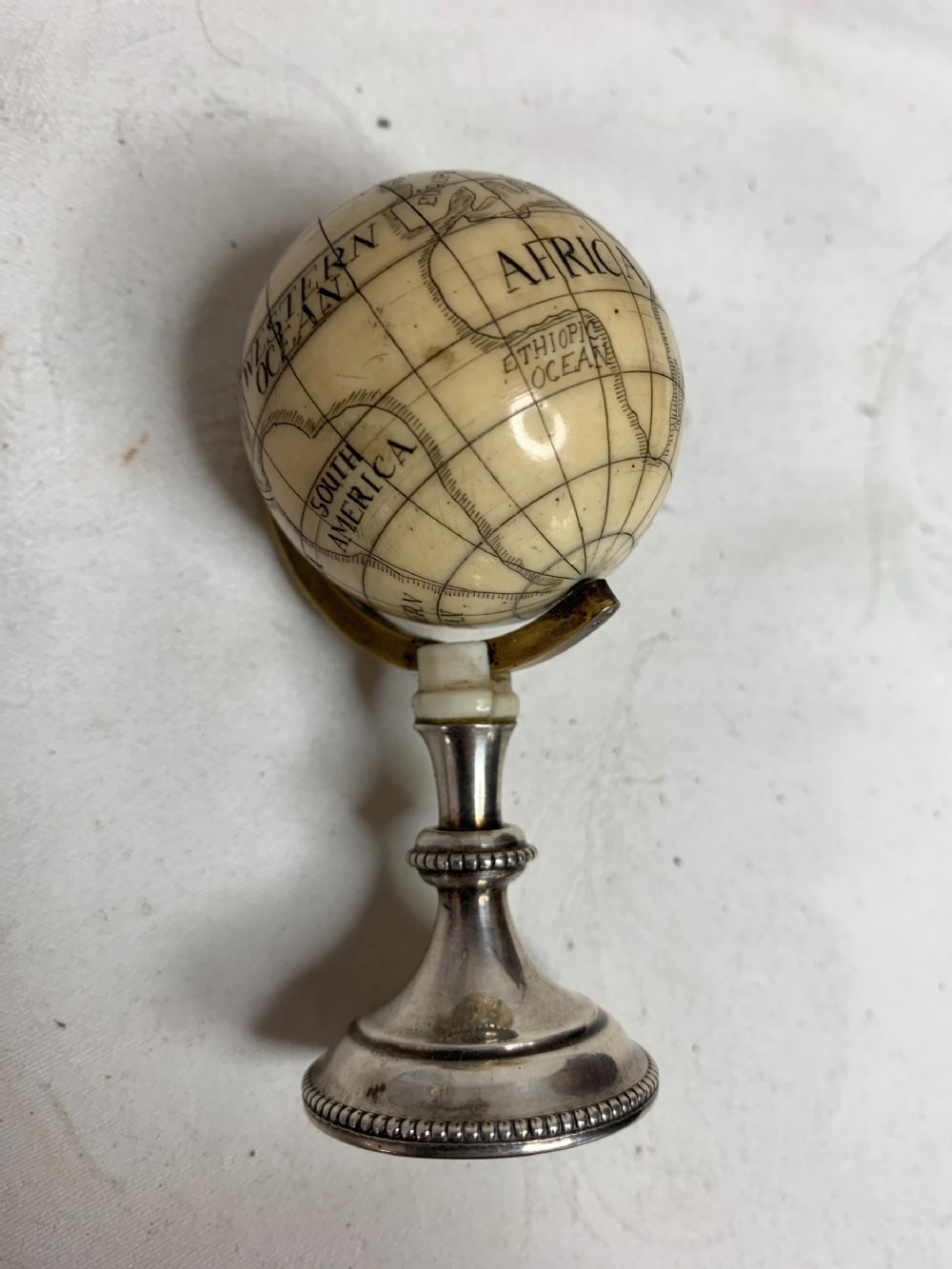 miniature ivory and silver globe 4cm diameter