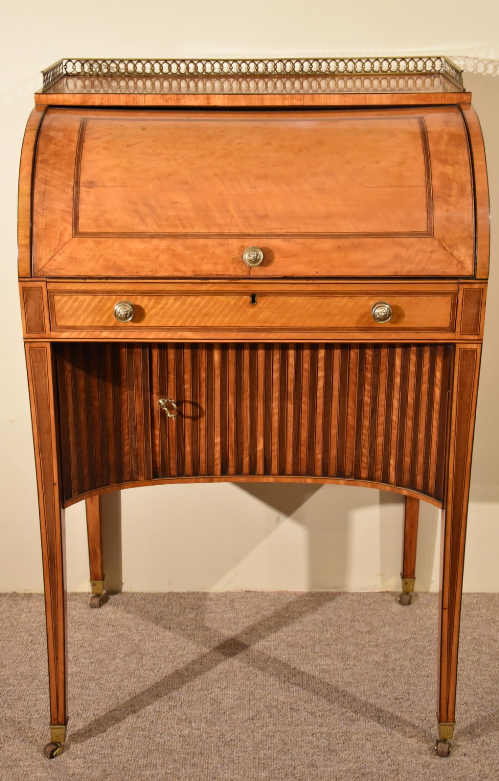 a fine quality late 18th century satinwood roll top writing desk