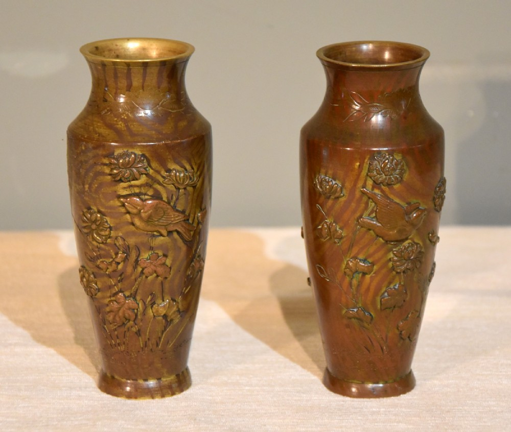 pair of diminutive patinated bronze vases