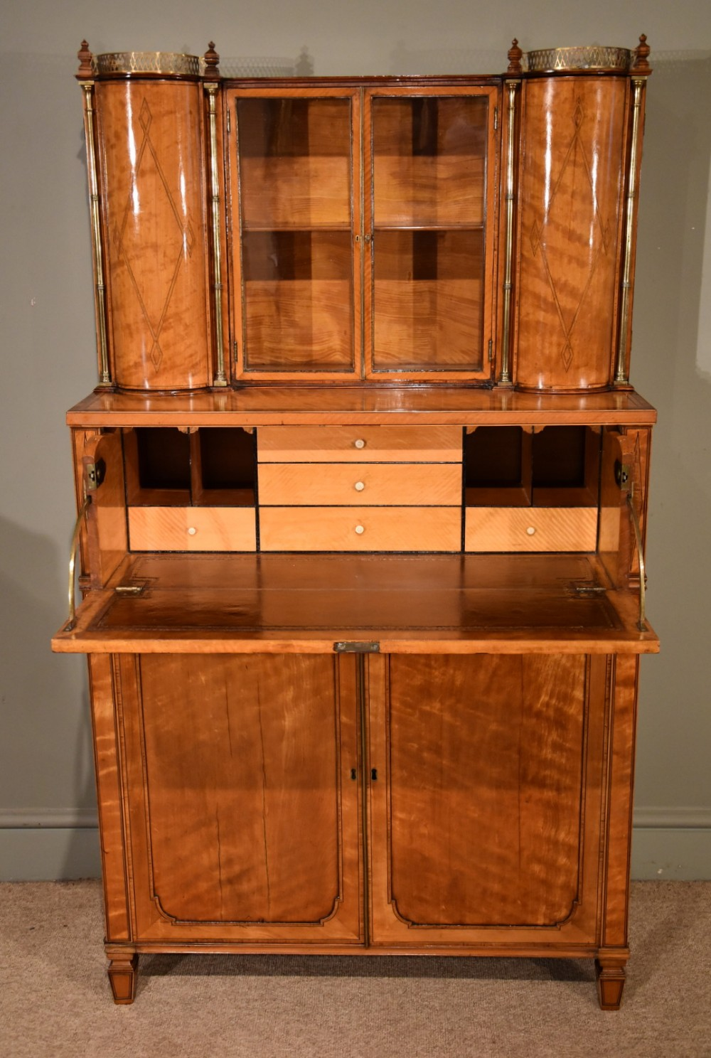 a fine regency satinwood secretaire cabinet