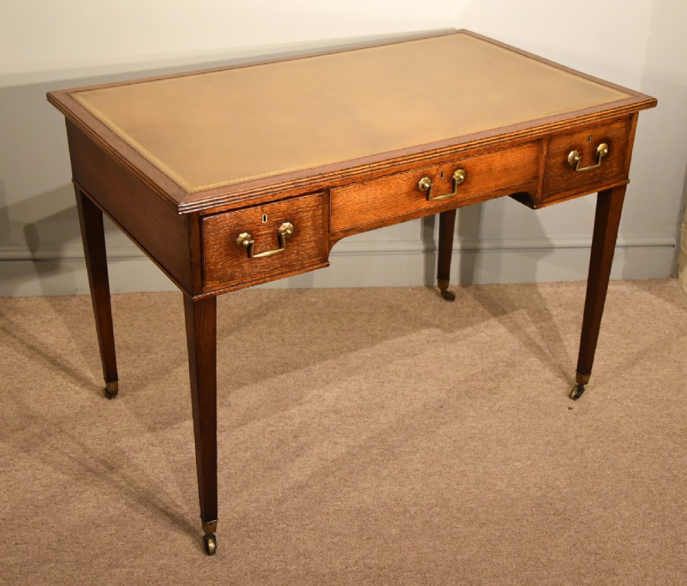 an elegant 19th century oak writing table