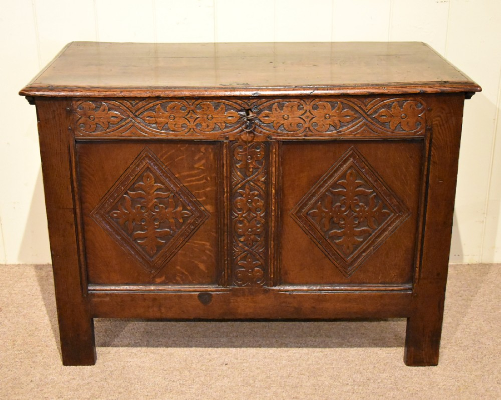 a small early 18th century oak two panelled coffer