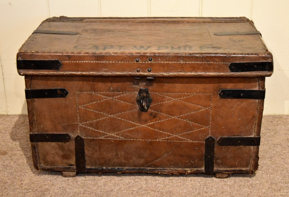 a mid 19th century leather and iron bound trunk
