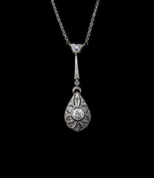 fine art deco 18kt white gold and diamond pendant with original 18kt gold chain c 1925