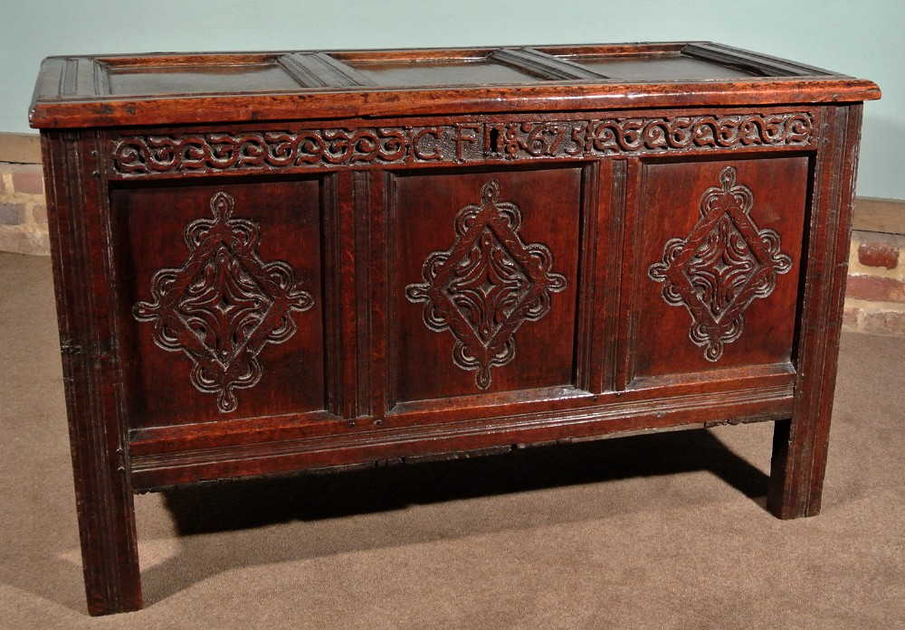 very good 17th century oak coffer boldly carved initialled and dated 1675