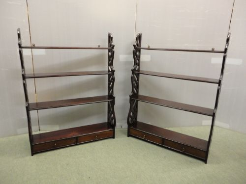 pair of mahogany wall displays