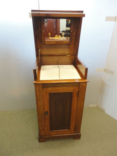 sink in mahogany cabinet