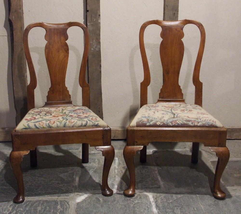 pair of queen anne walnut chairs circa 1720