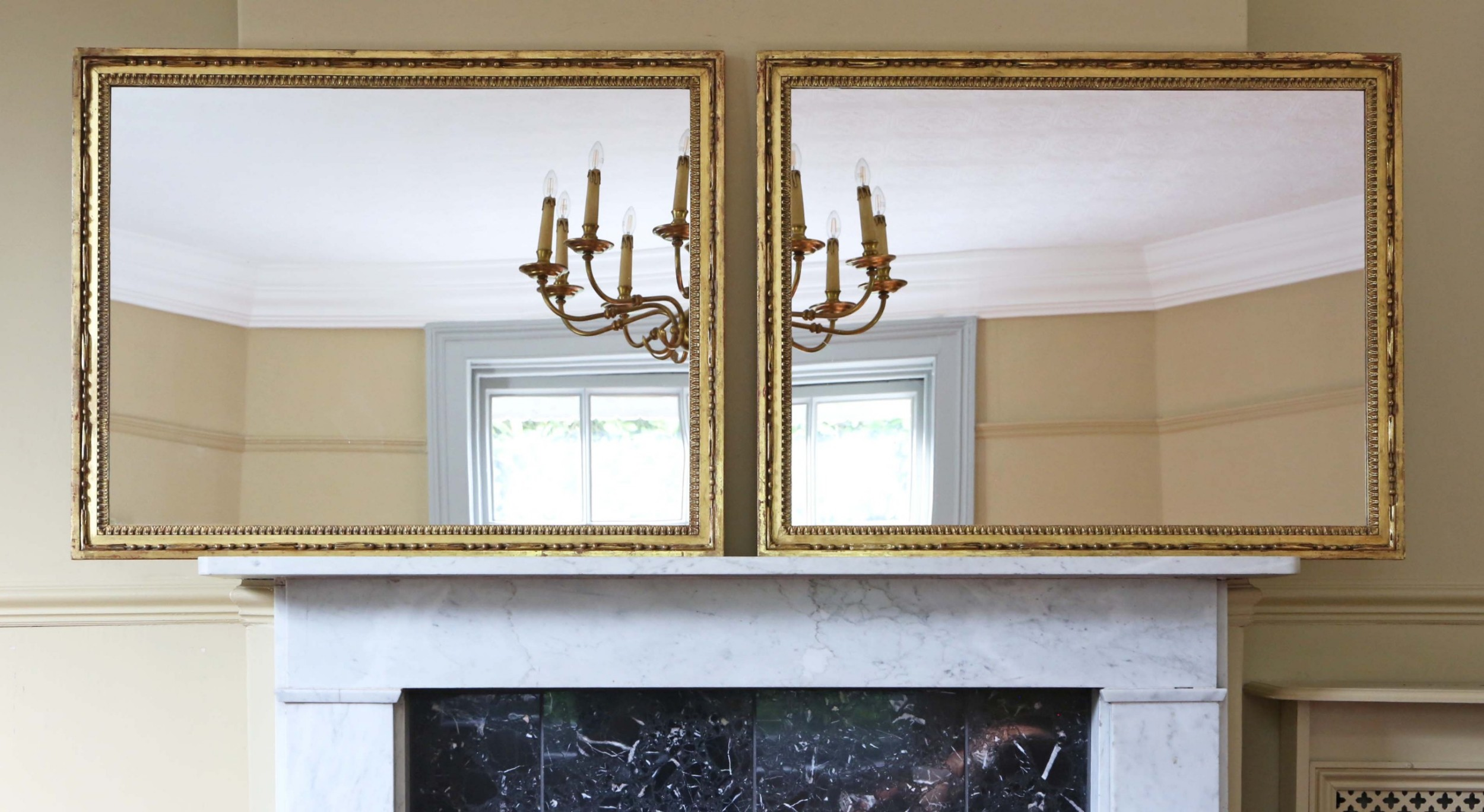 large pair of gilt 19th century overmantle mirrors