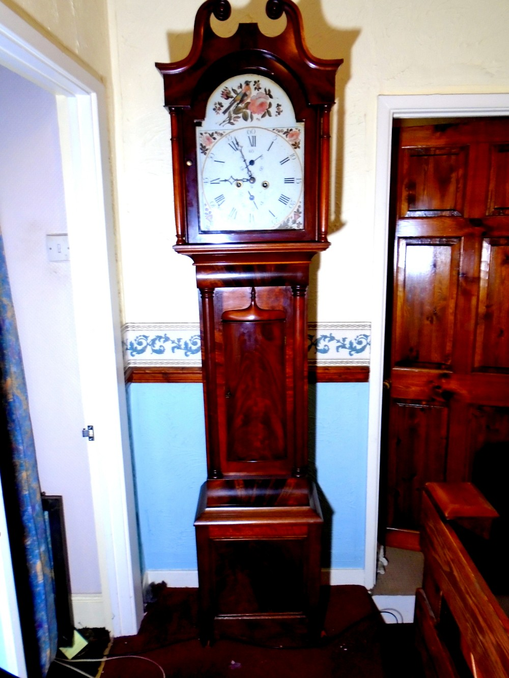 a fine flame mahogany 8 day scottish long case clock