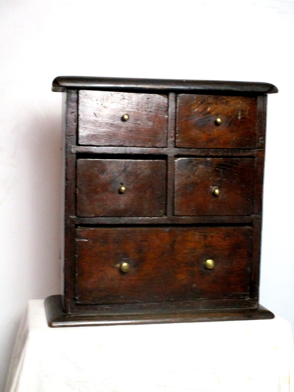 an extremely rare mid to late 17th century country house kitchen oak spice chest of drawers