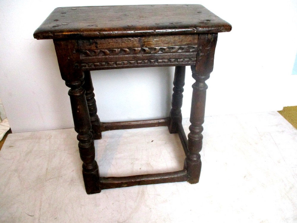 a very early 17th century small oak joint stool