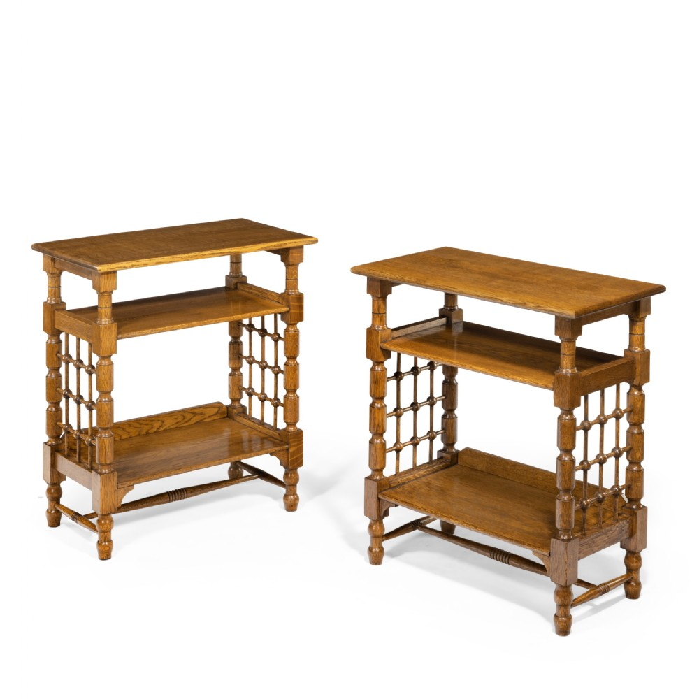 a matched pair of oak side tables attributed to libertys