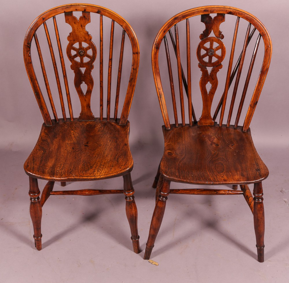 a near pair of 19th century yew wood kitchen chairs