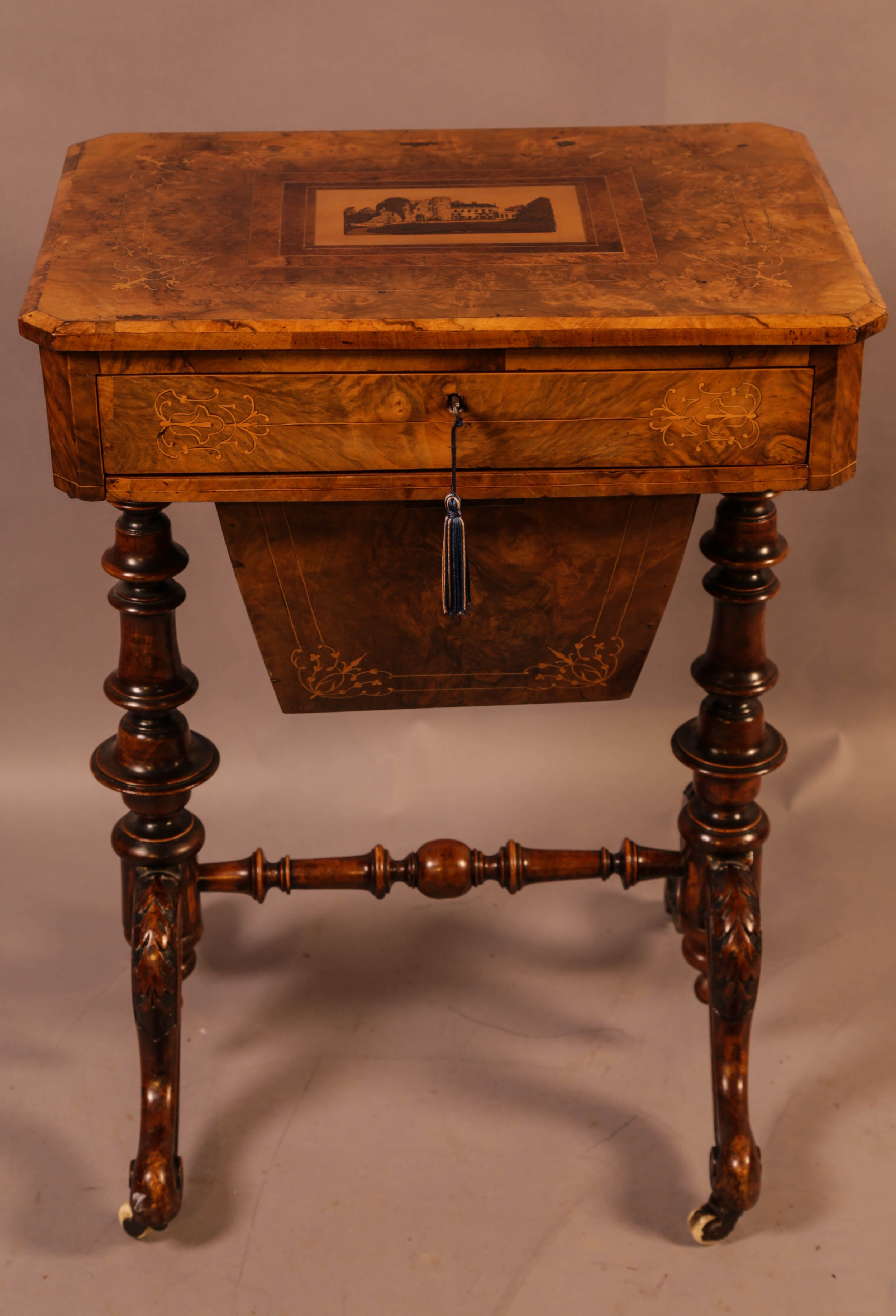 a good victorian ladies sewing table inlaid with castle ruins