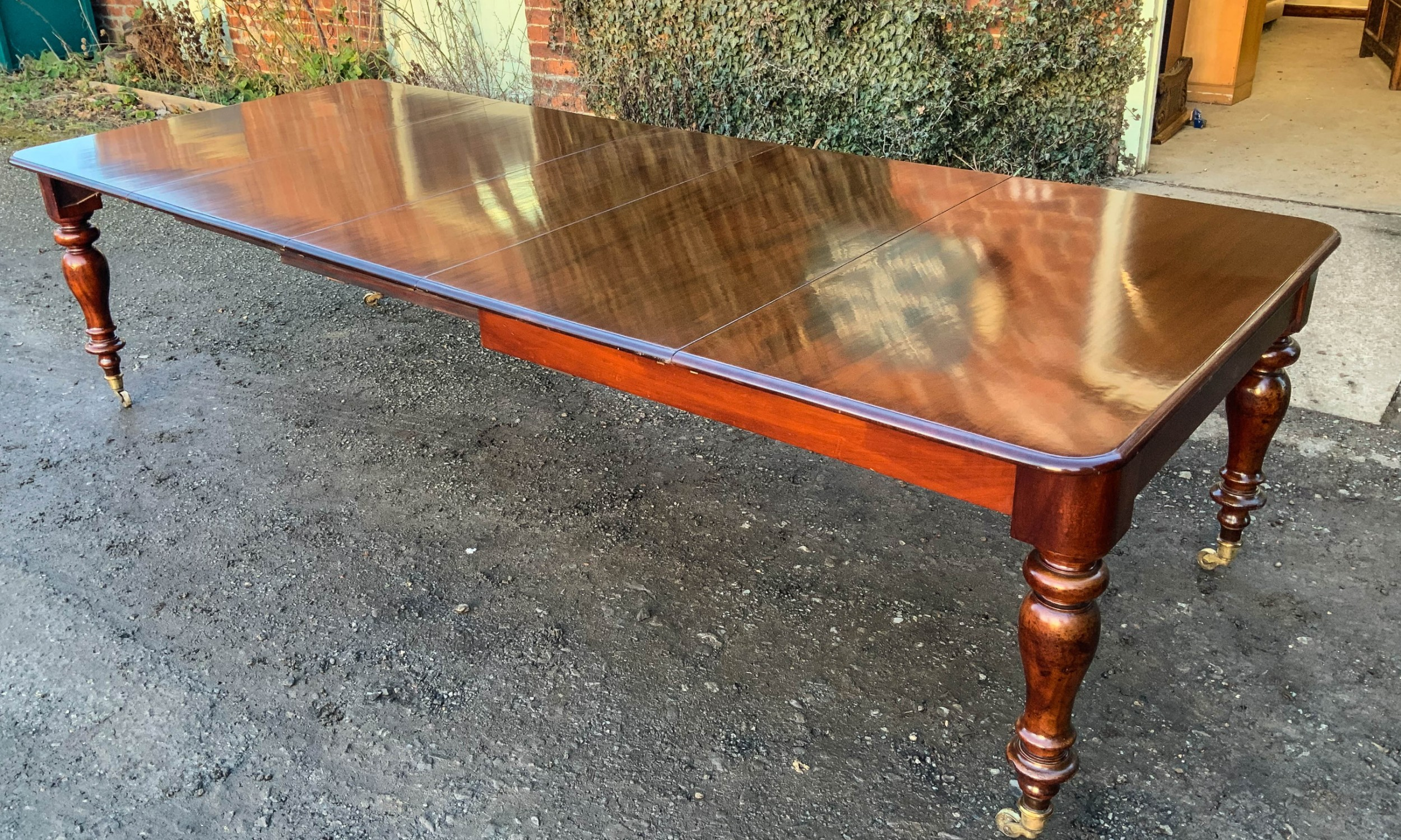 a victorian mahogany extending dining table with 3 leaves seats 12