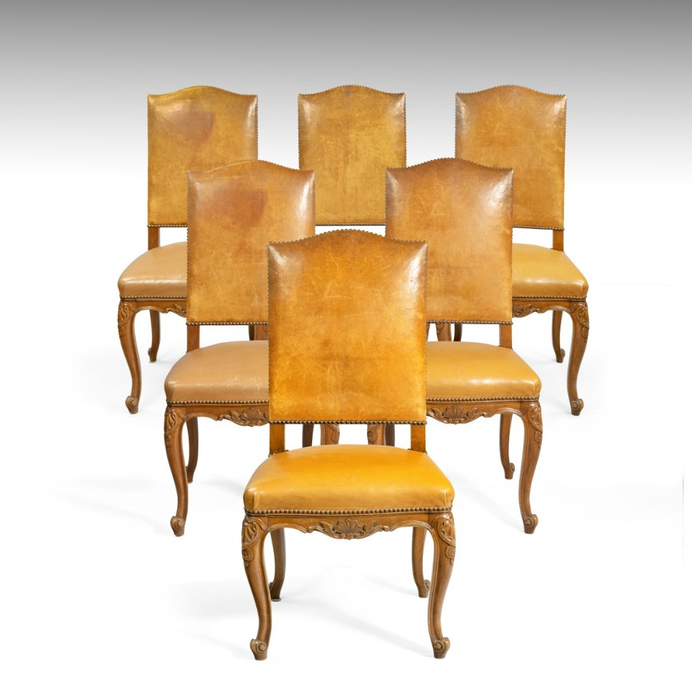 a set of six 19th century french leather upholstered chairs