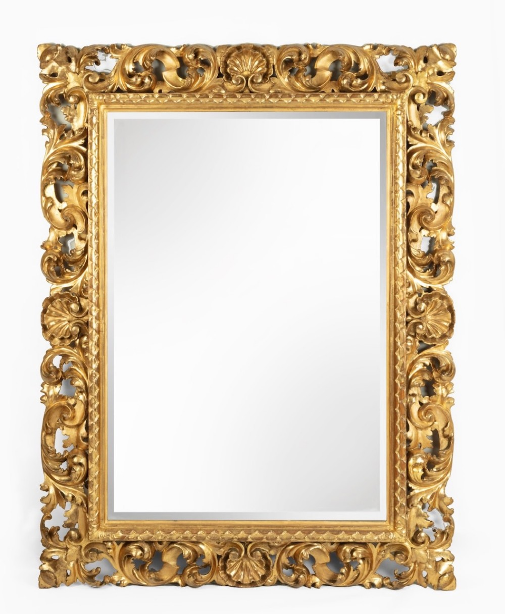 an unusually large 19th century italian carved wood gilded mirror