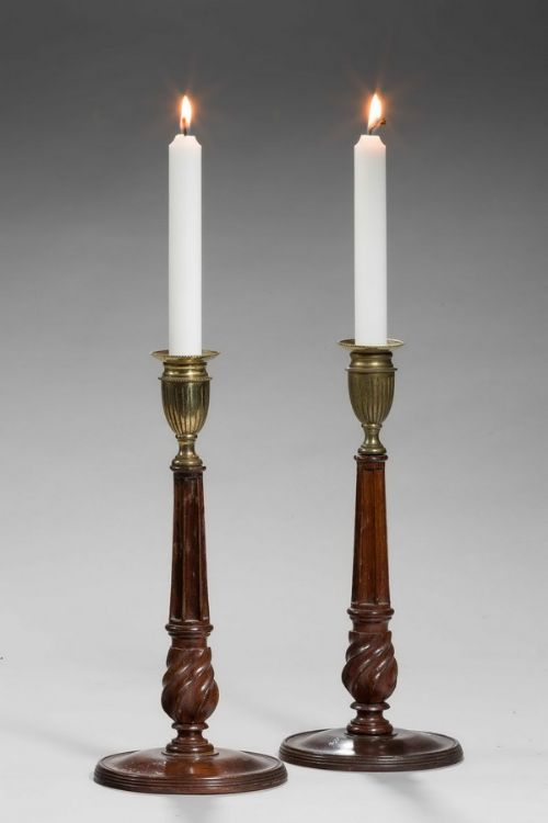 pair of george iii period mahogany and bronze candlesticks