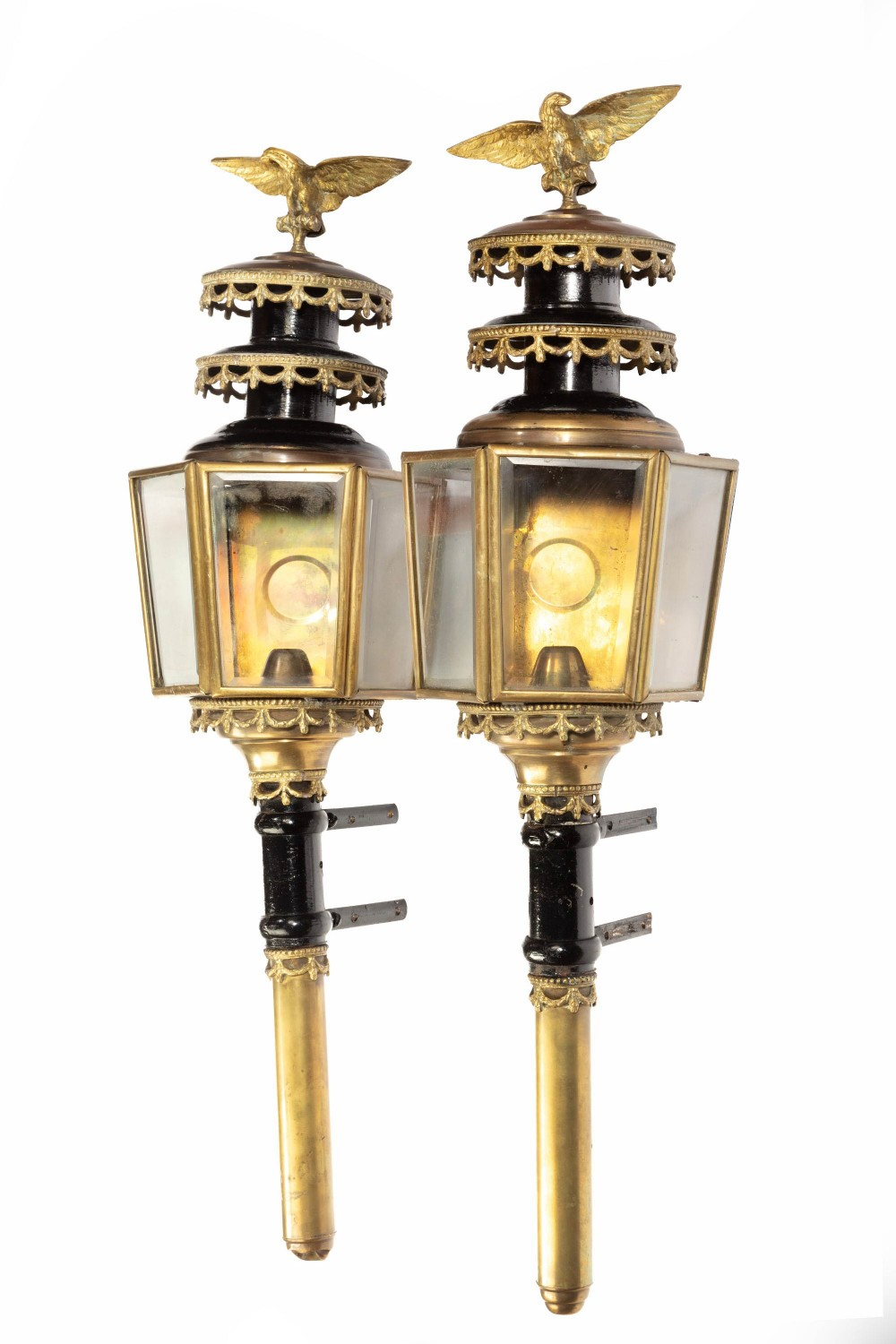 a pair of well patinated bronze and gilt bronze coach lamps