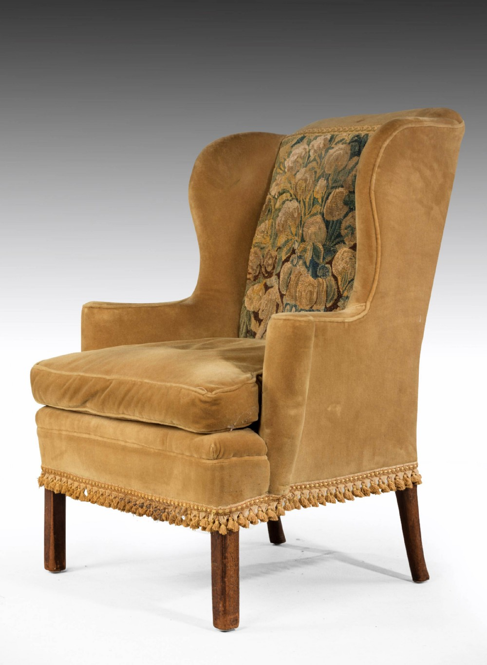 a george iii period wing chair incorporating a verdure tapestry panel